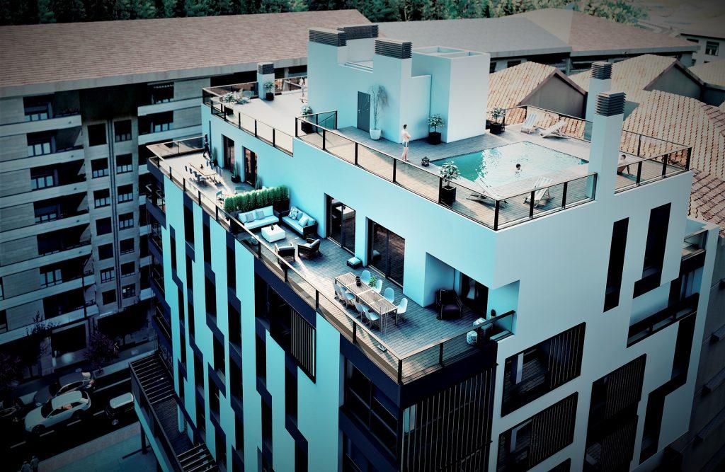 Vista aérea del Residencial Buenos Aires donde se visualiza todo el edificio y en especial los áticos y la cubierta transitable con piscina.